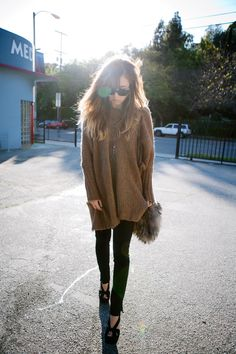 oversized sweater, black skinnies, black wedges and a fur purse...perfect