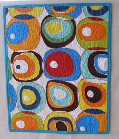 Alexander Henry fat quarter turned into art quilt.  Listen to my Quilted Cupcake podcast #13 for details.