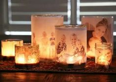 Using clear glue, coat the front of pictures and put them on the inside of a jar. Add a tea light candle and voila!
