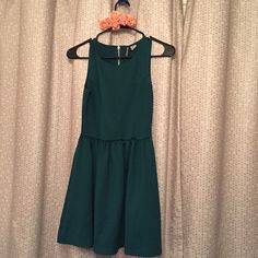 H&M forest green baby doll dress size 4 Great condition, stretchy material. I would say this runs a little bit small. H&M Dresses Mini