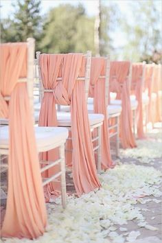 Draped linens weaved in and out of chair backs instantly dress up wedding ceremony seating for an elegant look- do this in a different color Coral Wedding Decorations, Ceremony Decorations, Wedding Themes, Wedding Dresses, Wedding Designs, Wedding Photos, Bridesmaid Dresses, Ceremony Seating, Wedding Ceremony