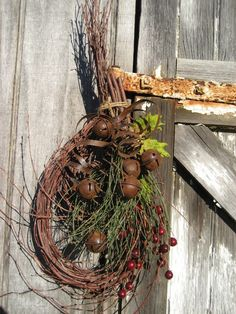 Primitive Twiggy Christmas Wreath...with pine, berries & rusty jingle bells.