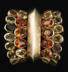 Citrine clip, Suzanne Belperron, 1938. Estimate 5,000 — 7,500 CHF. Lot sold 60,000 CHF. Photo: Sotheby's 2013 The central domed motif, flanked at either side with a double row of collet-set oval citrines, French assay and partial maker's marks.