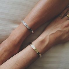 Gold Cartier love bracelets
