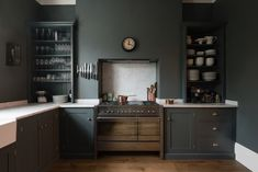 A dark green kitchen in London with cabinets from the Real Shaker Kitchen line from UK cabinetmaker deVol. See more Shaker-style cabinets in Remodeling Shaker-Style Kitchen Cabinets. Photograph courtesy of deVol. Shaker Style Kitchen Cabinets, Shaker Style Kitchens, Kitchen Cabinet Styles, Shaker Kitchen, Shaker Cabinets, Kitchen Shelves, Dark Cabinets, Green Cabinets, Wood Cabinets
