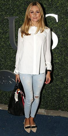 Olivia Palermo in a white blouse, ripped skinny jeans, and flats