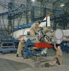 Technicians work on the Stentor rocket motor of a Blue Steel stand-off weapon in the Missile Servicing Bay, Scampton 1963 Rocket Motor, Anti Flash, V Force, Nuclear Force, Avro Vulcan, History Online, Royal Air Force, Military Vehicles, Aviation