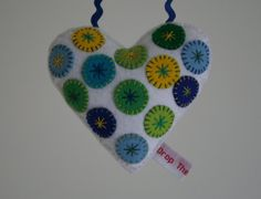 Hand stitched stuffed felt heart decoration  by DropTheWeasel