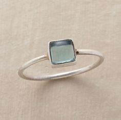 STORM AT SEA RING--Jane Diaz's stormy blue apatite cabochon is captured in sterling silver on a light, easy-to-wear wire band. Handcrafted. Whole sizes 5 to 9.