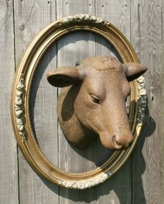 I have a great old frame that I will do this with when I get our Cow Head!  A new twist on the dead animal on the wall motif