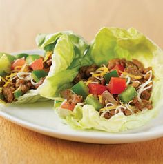 Turkey tacos wrapped in butter lettuce leaves are a low-carb change from regular tacos. Serve with a big squeeze of lime and a scoop of salsa.