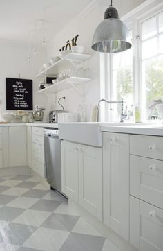 Gorgeous Swedish kitchen with white cabinets, open shelving, farmhouse sink (IKEA?), industrial style pendant, and gray checkerboard painted wood floors. Swedish Kitchen, Swedish Cottage, New Kitchen, Kitchen White, Kitchen Wood, Kitchen Design, Country Kitchen, Kitchen Colors, Kitchen Interior