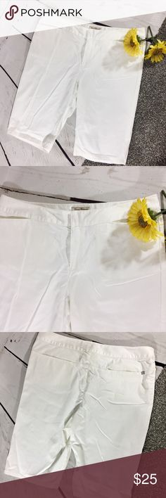 "{TOMMY BAHAMA} White Bermuda Shorts White Bermuda shorts by Tommy Bahama.  Silver Tommy Bahama emblem on back right pocket.  Has some stet h , 98% cotton, 2% Spandex .  EUC.  All measurements taken flat .  Size 12 measures 21"" waist to hem , 10"" rise , 15.5"" back waistband .  P-7 Tommy Bahama Shorts Bermudas"