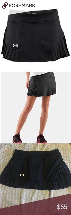 Under armor UA tennis match skort UA tennis match skirt.  Black size medium.  Nwot.  Got excellent reviews. Under Armour Skirts