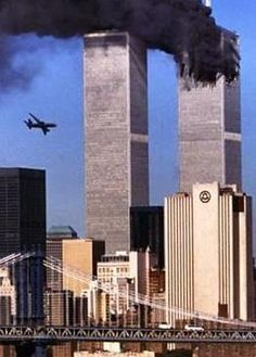 """Second plane hitting twin towers. """"One of the lessons of 9-11 is that evil is real and so is courage."""" - George W Bush"""