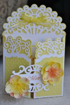 handmade Mothers Day card by wanspacher ... gatefold card ... yellow with white die cuts ... luv the flourishes in the die cuts ... dimensional pre=made flowers ... lovely card!!!