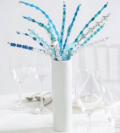 For some elegant flair, made some DIY beaded centrepieces with beads that suite your colour scheme.