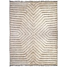 Couture Craft. Knotted by hand from lustrous banana silk with natural jute accents. Neutral and variegated colors and simple patterns let the craft speak for itself. These rugs are the strong silent type—a fab foundation for your floor that is packed with style. Each one takes a craftsman 4-6 weeks to make. #jonathanadler #homedecor