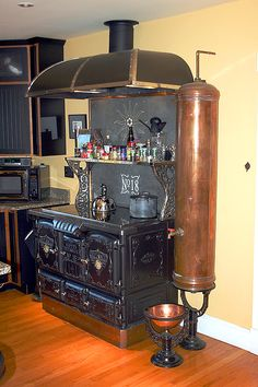 The antique stove is wonderful, but what is the copper tank? Hot water?