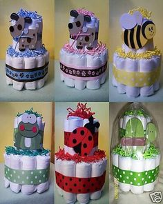 Each Mini Diaper Cake consist of Huggies diapers, wooden animals, ribbon to match the theme you request, and/or personalization of the diaper cake. Each mini diaper cake can be used at a baby shower for a centerpiece or a nice gift. Idee Baby Shower, Shower Bebe, Baby Shower Diapers, Baby Shower Favors, Baby Shower Cakes, Baby Shower Themes, Baby Boy Shower, Baby Showers, Cheap Baby Shower Gifts