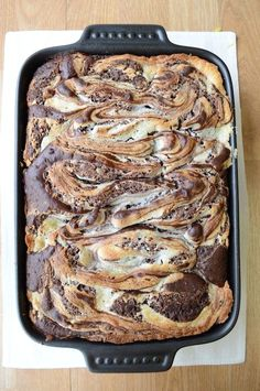 Earthquake Cake Recipe ~  it's rich with german chocolate flavor,  pecans, coconut, and the secret ingredient – a powdered sugar, cream cheese, & butter swirl layer... yummy!