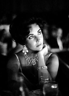Elizabeth Taylor watches Eddie Fisher as he performs at the Tropicana, Las Vegas, 1959. (Photo: John Bryson/Time & Life Pictures/Getty Images)