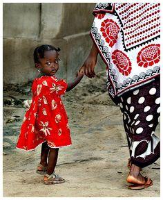 mama and beautiful mtoto wearing. mama wearing a beautiful khanga outfit.