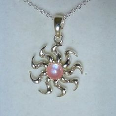 Check out this item in my Etsy shop https://www.etsy.com/uk/listing/521568667/sterling-silver-pink-sun-pendant-with-16