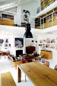 contemporary loft interior. David Delfin's Madrid Loft (marie claire france) Mouille, rosewood, Perriand, wood slab, fireplace
