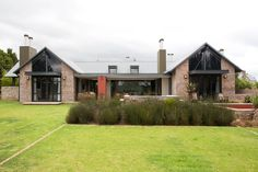 Inspired by nearby farm buildings this home designed by architects Pieter Mathews and Anton Smit of Mathews & Associates Architects (086 111 6222 or maaa.co.za) features an I-beam framework with pitched S-rib roof sheeting, corrugated iron cladding and stock brick walls.