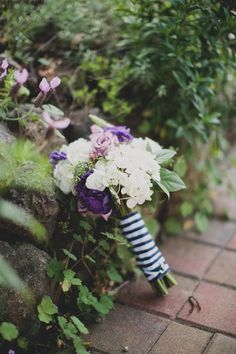 A mix of purple, lavender and white flowers, tied with striped fabric | East Bay Garden Wedding | Venue: The Gardens at Heather Farm | Katie Pritchard Photography