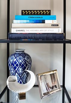 Nothing like a chic stack of books and blue-and-white decorative accents!