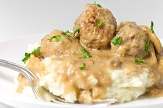 Meatballs simmered in a mushroom cream sauce served over creamy mashed potatoes. It doesn't get more comforting then this.