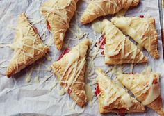 Rhubarb Toaster Strudels, makes 8 to 10.    Needed: 2 cups finely diced rhubarb (I used frozen and thawed before use), 1/3 cup sugar, 1/4 teaspoon ginger, one sheet of puff pastry, 1/2 cup butter and 1 to 1 1/3 cup powdered sugar.