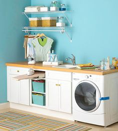 Budget-Minded Update...Convert a corner of a room into a tidy and efficient laundry center with a couple of cabinets and a small drop-in laundry tub. If you have a front-loading washer, extend the laminate countertop over it to create more work space.