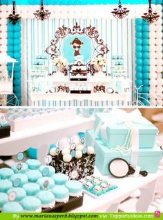 Breakfast at Tiffany's Party - Party table setting with chandeliers, balloon backdrop and wall hanging