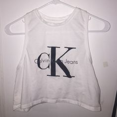 Calvin Klein Top White cropped tank with black Calvin Klein jeans logo. Never worn, no stains, no defects, and can fit an xs as well. NO TRADES. Calvin Klein Tops Crop Tops