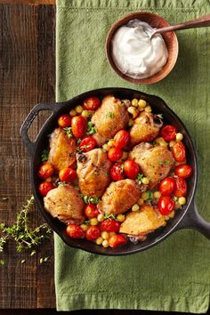 Crispy Chicken Thighs with Smoky Chickpeas  - CountryLiving.com