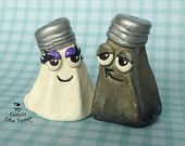 not sure what kind of message this sends about the bride and groom, but lets hope its 'we belong together - like salt and pepper' 8^)  all in all, a cute idea, and well presented.  could make a nice topper on a whimsical cake.