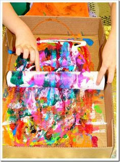 Toilet paper tube printing/painting - Start by covering your paper towel tube with a paper towel. Make sure that you have enough tubes for each child. Let the children squirt paint all over a shallow box.  Lay the paper towel tube on one end of the box.  Apply light pressure, gently roll the tube across the box, just enough to cover it with paint.  Let it dry.  Repeat!           Repeat!