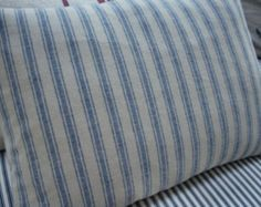 This pillow is made from beautiful high quality railroad stripe woven French look ticking -- Marine Blue stripes on a creamy natural background. The pillow back is constructed like a slipcover so it may be removed from the new 14 X 18 Down & Feather pillow insert. The pillow back is made of a coordinated natural colored Twill. SHIPPING ---- I ADJUST SHIPPING CHARGES FOR MULTIPLE PILLOW PURCHASES - EXACT SHIPPING COST DETERMINED BY WEIGHT TO SPECIFIC ZIPCODE OF BUYER....SAVINGS FROM COMBI...