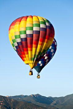 Two hot air balloons over Colorado Springs