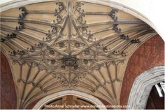 Ceiling of the Anne Boleyn's Gate  Hampton Court Palace England.  Several symbols are visible such as the Tudor Rose in the center, a fleur-di-lis, the Boleyn falcon and the Beaufort portcullis.