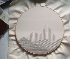 Big Geometric Mountain Embroidery: Here's a soothing weekend-length embroidery project that packs a lot of punch and only uses very simple embroidery techniques. Working with such a big hoop can… Simple Embroidery Designs, Japanese Embroidery, Embroidery Patterns Free, Silk Ribbon Embroidery, Hand Embroidery Patterns, Diy Embroidery, Embroidery Stitches, Embroidery Digitizing, Beginner Embroidery