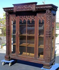 Gothic Revival China Cabinet: http://www.google.co.uk/imgres?q=gothic+revival+furniture=1=en=1366=598=isch=-0QR-iRXvGFziM:=http://rarevictorian.com/2007/03/oak-gothic-tobytobey-china-cabinet.html=wb_RESsIC7kxHM=272=320=hfJUTt78D5D6sgbG5gE=1=hc=295=212=1460=244=207=148=111=2=8=146=111=163=25=1t:429,r:17,s:163