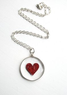 Copper heart fused within. Another lovely by Urban Fusions! Large Red Heart Fused Glass Pendant Clear Glass by UrbanFusions