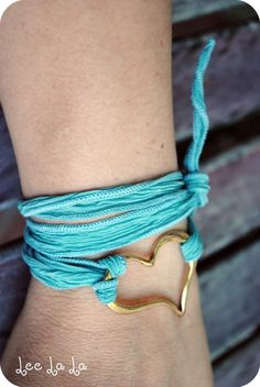 Not diggin' the heart. Maybe if it were smaller and silver. But...LOVE the turquoise wrap bracelet!
