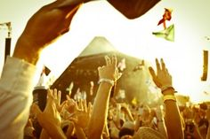 Point of view within a crowd of music fans during a performance at a music festival