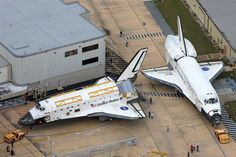 Space Shuttle Discovery passes Atlantis on her journey to the VAB, and later, the Smithsonian. For a brief few seconds, the two spacecraft were a few feet apart, a scene which will never be replicated.