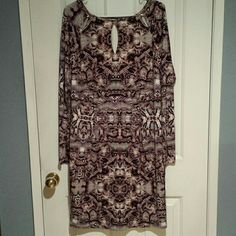 Jennifer Lopez Long Sleeve Dress Beautiful Jennifer Lopez size XL long sleeve. Back hidden zipper. Fully lined. Unique key hole cut outs along neck line. Burgundy/ Merlot in color. 95% polyester 5% spandex. Machine washable. Very good condition. Jennifer Lopez Dresses Long Sleeve